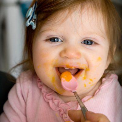 Mia eating egg yolk