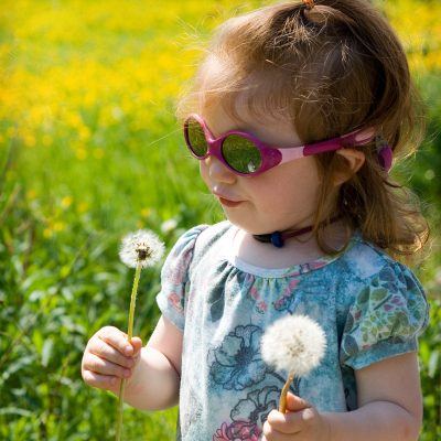Mia and dandelions